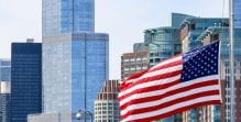 New York City skyline with a billowing United States of America flag