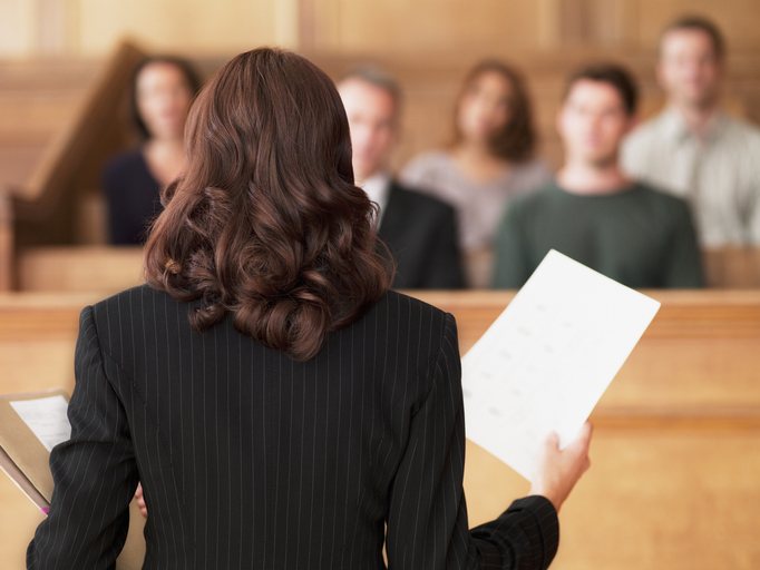 A barrister stands before a court of law giving evidence to a court of law